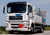Linde truck transporting gas cylinders