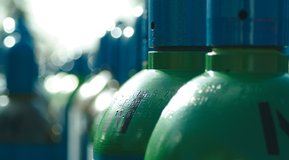 Cylinders with dark green shoulder (Argon), Close up.