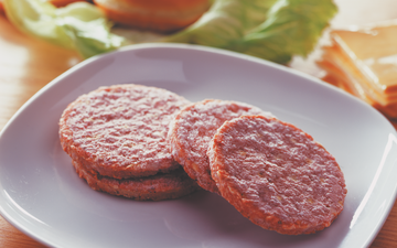 picture shows burger patties on a plate