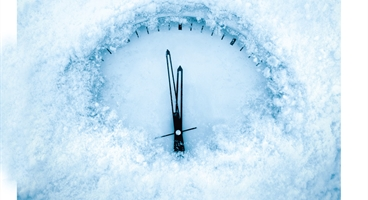 A clock frozen in time.  Im agine of a clock underneath some snow and ice