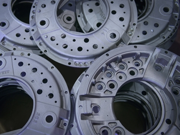Close up of industrial clutch parts on production line, overhead view. The image is used for the Heat Treatment website.