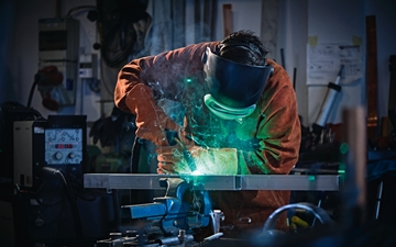 Image shows craftsman while welding.