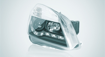 Automotive headlight. The image has been retouched according to the PLASTINUM imagery. This image is another version of ID 78246 (different format and colour gradient in the background).